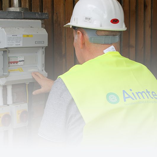 An Aimteq engineer inspecting an enclosure