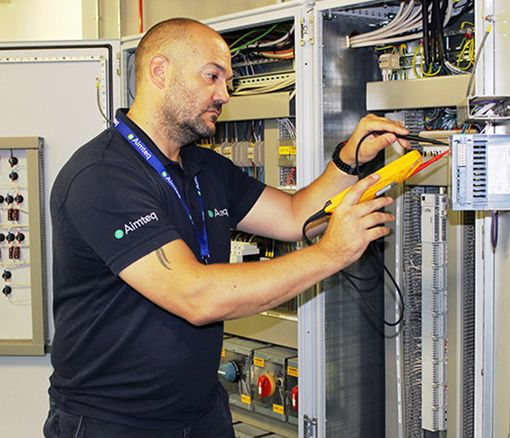 An Aimteq engineer running maintenance checks on a BMS system