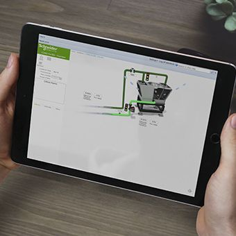 A Schneider Electric EcoStruxure BMS page being viewed on a tablet